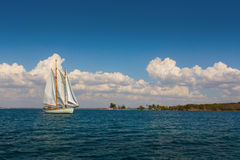 Sailing on sea with white clouds and blue sky Stock Photos