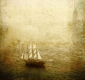 Sailing ship. Vintage view of an old wooden sailing ship in the sea royalty free stock photos