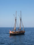 Sailing ship. Ship sailing in blue sea Stock Images
