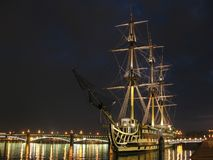 Sailing ship. The lit sailing ship at night coast stock image