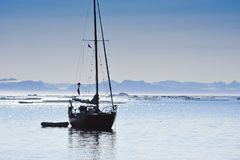 Sailing ship in arctic sea with copy space Stock Images
