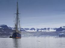 Sailing ship in arctic sea with copy space Royalty Free Stock Photos