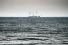 Sailing ship on the Baltic sea. Three-masted full-rigged frigate ship Dar Mlodziezy on the high seas. Gdansk bay, Pomerania, Poland Royalty Free Stock Photos