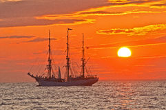 Tall ship in Sunset. Norwegian tall ship Christian radich in the Bay of Finland. It is a school ship for training og young cadets Royalty Free Stock Images
