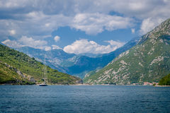 Sailing ship in the Bay of Kotor mountains Royalty Free Stock Photography