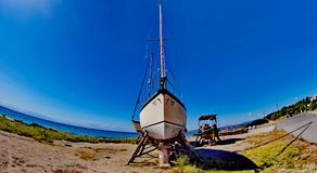 Sailing ship and a boat. A picture of a sailing ship and a big boat in the background near the sea,in an area in Greeece ,halkidiki,in a summer day of september Royalty Free Stock Images
