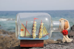Sailing Ship in the Bottle. Near the Ocean Stock Image