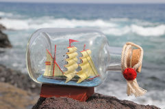 Sailing Ship in the Bottle. Near the Ocean Royalty Free Stock Photo