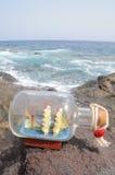 Sailing Ship in the Bottle. Sailing Ship in a Bottle near the Ocean Stock Photos