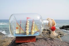 Sailing Ship in the Bottle. Near ocean Royalty Free Stock Images