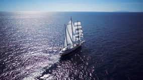 Sailing ship in calm weather sailing on the ocean stock video