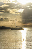 Sailing Ship Crossing The Sun Glitter Royalty Free Stock Photos