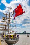 Sailing ship Cuauhtemoc seen wth huge waving Mexican flag in Antwerp during the Tall Ships Races 2016 event Stock Photography
