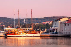 Sailing ship docked on Krk port morning light - Croatia Stock Images