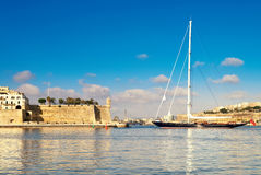 Sailing ship enters Grand Valetta bay in Malta Stock Images
