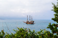 Sailing ship floating in the sea Stock Images