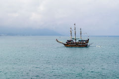 Sailing ship floating in the sea Stock Image