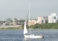 Sailing ship floats on the river Stock Photography