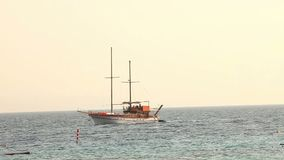 Sailing ship floats in the sea, sailing yacht, sea walk on a sailing yacht, Silhouette of solitary yacht without sails. Sailing ship floats in the sea, sailing stock video
