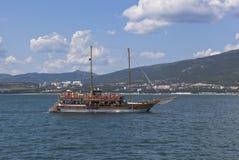 Sailing ship Gloria in Gelendzhik Bay in the background of Cape Thin. Gelendzhik, Krasnodar region, Russia Stock Image