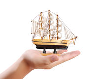 Sailing ship in the hand. Businessman royalty free stock photo