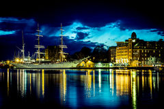 Sailing ship in the harbor and a castele at night. Sailing ship in the harbor and a castle at night with nice light reflection in the water Stock Images