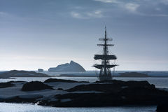 Sailing ship among the icebergs Stock Photos