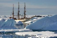 Sailing ship among the icebergs. Antarctica royalty free stock photos