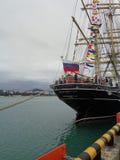 Sailing ship Kruzenshtern at berth, the city on horizon, Sochi, Russia. Black Sea tall ships regatta, sailboat Kruzenshtern at the pier Royalty Free Stock Photos