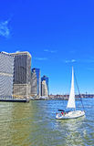 Sailing ship and Lower Manhattan of New York on background Royalty Free Stock Images