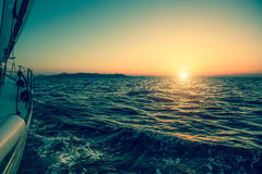 Sailing ship luxury yacht boat in the Sea during sunset. Stock Photography