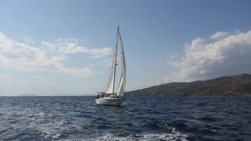 Sailing ship luxury yacht boat with white sails in the Sea. stock footage