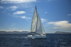 Sailing ship luxury yacht with white sails in the Aegean Sea. Sport. Royalty Free Stock Images