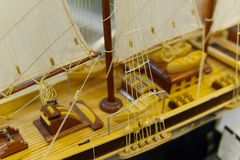 Sailing ship model in souvenir shop, closeup. Handmade sailboat miniature in gift market. Showcase with frigate figurine stock image