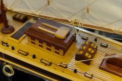 Sailing ship model in souvenir shop, closeup. Handmade sailboat miniature in gift market. Showcase with frigate figurine stock photography