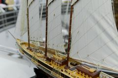 Sailing ship model in souvenir shop, closeup. Handmade sailboat miniature in gift market. Showcase with frigate figurine stock photos