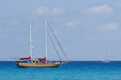Sailing ship moored on a blue sea Stock Photography