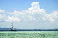 Sailing ship off Koh Kradan. In the Andaman Sea, with the Trang coastline in the background, Thailand stock image