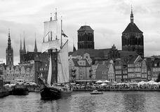 Sailing Ship in Gdansk Harbor. Dutch sailing ship in Gdansk old harbour, Poland. The vessel is from ca. 1930, the town in the background is medieval with tower Royalty Free Stock Photos