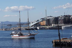 Sailing ship in Oslofiord. Sailing ship in front of Aker pier (Aker brygge) near Oslo harbour Royalty Free Stock Photos