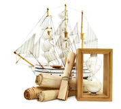 Sailing ship with paper scrolls an hourglass Stock Image