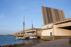 Sailing ship passing an opened concrete bridge Royalty Free Stock Photo
