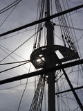 Sailing ship rigging backlit by sun. Sailing ship in Baltimore`s Inner Harbor with rigging backlit by sun Stock Image