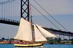 Sailing Ship on a river passing a bridge Royalty Free Stock Photos