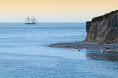 Sailing ship sails along the coast of Langeland Royalty Free Stock Images