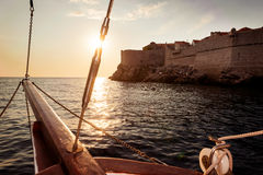 Sailing ship sails into sunset near Dubrovnik Royalty Free Stock Photography