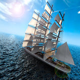 Sailing ship at sea. Sailing ship in the vast ocean with small waves is getting all the sails filled with sea breeze Stock Photo