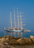 Sailing ship in the sea not far from the shore Royalty Free Stock Photos