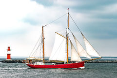 Sailing ship on the sea. Red Tall Ship and Lighthouse Royalty Free Stock Photography
