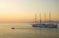 Sailing ship in the sea at sunset Royalty Free Stock Images